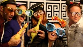 Image: Attendees at ONA's opening reception smile for a photo booth camera at the Rincon Center in San Francisco Thursday night. (Photo by Jill Knight)