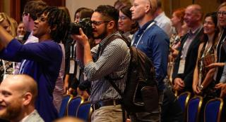 Christian Monterrosa of the ONA Student Newsroom photographs the opening of #ONA17 conference in Washington, D.C. (Photo: Curt Chandler)