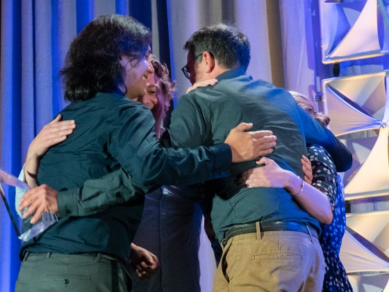 Journalists from Trint share a group hug after winning an OJA. (Photo: Violet Wang)