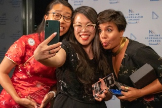 Sisi Wei, Julia B. Chan and Lam Thuy Vo make a selfie in the red carpet area after their team, Journalists of Color Slack Administrators, won the ONA Community Award at the 2019 Online Journalism Awards. Photo by Daja Henry